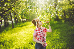 Princess girl breathing a apple flower in sunset light, profile Stock Photography