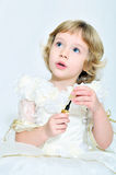 Princess girl playing with lipstick Royalty Free Stock Photo