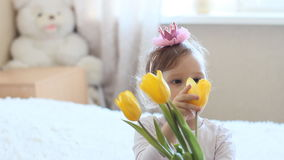 Princess girl with yellow tulips. In hands stock video