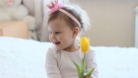 Princess girl with yellow tulips. In hands stock footage