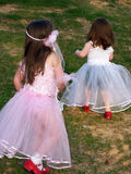 Princess Girls. Girls playing Princess Dress-up with Red Glitter Dorthy Shoes on Stock Photos