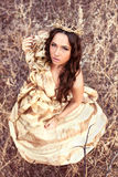 Princess in gold dress Royalty Free Stock Photography