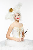 Princess with a golden crown in a white dress. Nobility royalty free stock photography