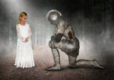Princess, Knight, Child Playing, Make Believe, Pretend. A young girl plays make believe and pretends to be a princess with a knight in shining armor. The hero royalty free stock image