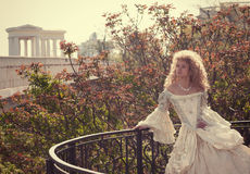 Princess leaning on railing of the balcony Stock Images
