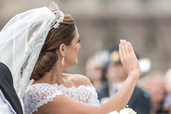 Princess Madeleine waving to the crowd. STOCKHOLM, Sweden - JUNE 8: Princess Madeleine waving to the crowd on the carriage to Riddarholmen after the wedding with Royalty Free Stock Images