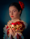 Princess Offering Heart Shaped Petals. Portrait of a girl wearing a princess dress offering a bowl of heart shaped candy royalty free stock image