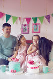 Princess party. Family celebrating birthday princess party of two 6 years old children Stock Photo
