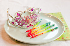Princess party tiara and birthday candles Royalty Free Stock Photo
