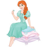 Princess and the pea. Cute red haired princess and the pea Royalty Free Stock Photos