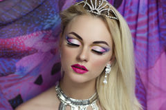 Princess. Portrait of beautiful young sexy lady model woman actress, princess. Perfect makeup, long eyelashes, clean soft skin, gentle pink lips Royalty Free Stock Photography