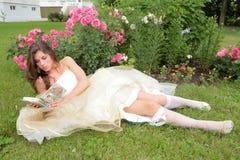 Princess reads book Stock Photo