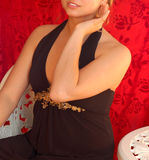 Princess on red velvet. Young rich woman on bistro chair. Camera: Nikon D50, lens: 50mm royalty free stock images