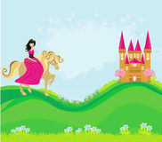Princess riding a horse into the castle Stock Image