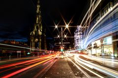 Princess Street at night. The light flow of traffic through the heart of Edinburgh capital of Scotland Stock Images