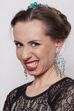Princess terrible. Young woman in evening make up a face twisted disgruntled Stock Image