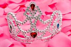 Princess Tiara. A princess tiara sitting on a pink flower petal background, princess tiara Stock Photography