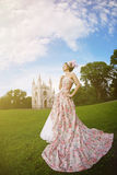 Princess in an vintage dress before the magic castle Royalty Free Stock Images