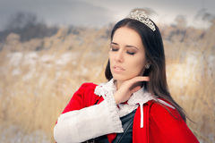 Princess Wearing Tiara and Red Cape Outside Royalty Free Stock Images