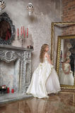 Princess in a white dress in the palace Royalty Free Stock Image