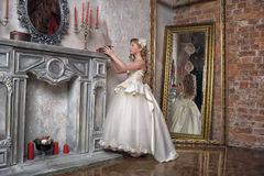 Princess in a white dress in the palace Stock Photography