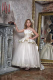 Princess in a white dress in the palace Royalty Free Stock Photography