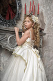 Princess in a white dress in the palace Stock Photos