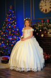 Princess in a white dress retro at the Christmas tree Stock Photography