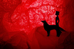 Princess with a wolf. Cut silhouettes of princess and a wolf royalty free stock photo