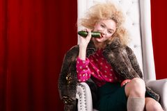 Princess woman in fur coat sitting on throne Royalty Free Stock Photography