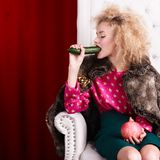 Princess woman in fur coat sitting on throne Stock Photo