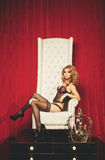 Princess woman in lingerie sitting on throne Royalty Free Stock Photos