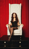 Princess woman in lingerie sitting on throne Royalty Free Stock Image