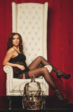 Princess woman in lingerie sitting on throne Royalty Free Stock Photography