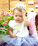 Princess' Work is Never Done. Toddler playing princess , wearing tiara, tutu and holding wand Stock Photography