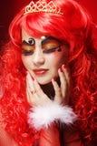 Princess z jaskrawym czerwonym włosy Zdjęcia Royalty Free