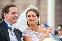 Princesse Madeleine et Chris O'Neill montent dans un chariot sur le chemin à Riddarholmen après leur mariage Image libre de droits
