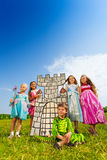 Princesses and boy as monster near drawn tower Royalty Free Stock Images