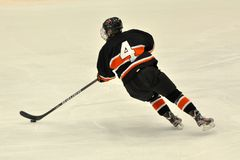 Princeton player in NCAA Ice Hockey Game Royalty Free Stock Photo