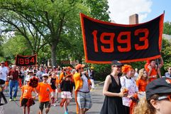 The Princeton University 2015 P-rade. PRINCETON, NJ -MAY 30, 2015- Princeton University alumni dressed in orange and black march joyously in the P-rade, the Royalty Free Stock Photography