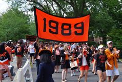 The Princeton University 2015 P-rade. PRINCETON, NJ -MAY 30, 2015- Princeton University alumni dressed in orange and black march joyously in the P-rade, the Stock Images