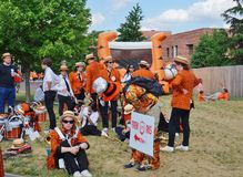 The Princeton University 2015 P-rade. PRINCETON, NJ -MAY 30, 2015- Princeton University alumni dressed in orange and black march joyously in the P-rade, the Royalty Free Stock Photos