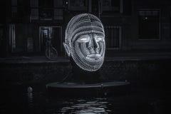 Principal flotante hecho de luces en un canal de Amsterdam Imagen de archivo
