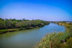 The principal Rio Grande River in Nuevo Progreso, Mexico. A large flow of water river connecting the Mexico-United States border Nuevo Progreso royalty free stock image