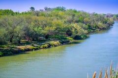 The principal Rio Grande River in Nuevo Progreso, Mexico. A large flow of water river connecting the Mexico-United States border Nuevo Progreso stock photo