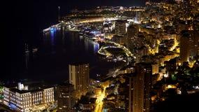 Principality of Monaco, brightly illuminated luxurious city at night aerial view. Stock photo royalty free stock photo