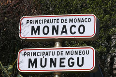 Principality of Monaco sign. Close up of street sign saying Principality of Monaco in both French and Monegasque languages Royalty Free Stock Photography
