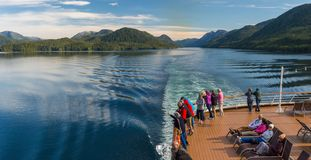 Principe Channel, BC, Canada - September 13, 2018: Cruise ship passengers viewing beautiful scenery of the Inside royalty free stock photo