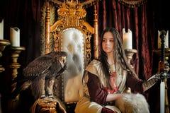 Principessa del guerriero sul trono Fotografia Stock