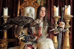 Principessa del guerriero sul trono Immagini Stock